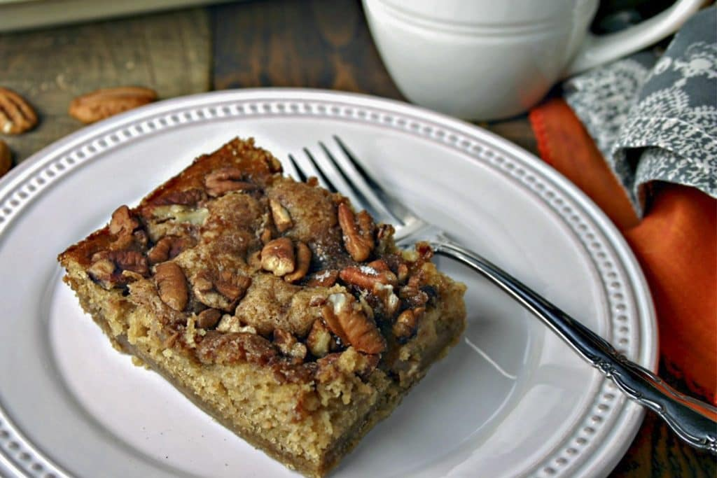 A slice of Brown Sugar Pecan Coffee Cake on a plate on a table
