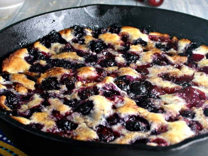 A cast iron skillet with Cherry Berry Cobbler