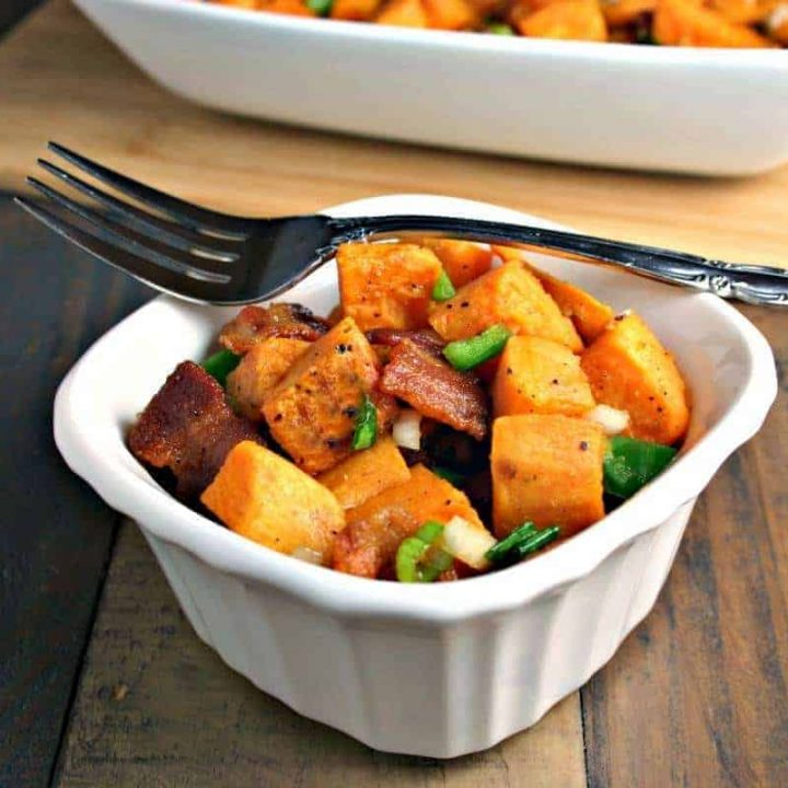 A bowl of food on a plate, with Sweet Potato salad