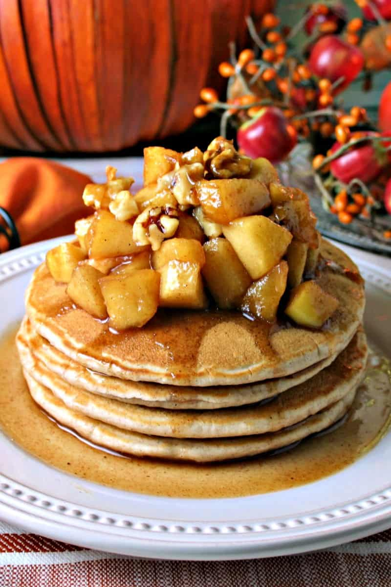 A plate of pancakes on a table, with Apple Cinnamon Pancakes