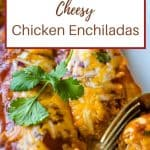 chicken enchiladas on a plate with a gold fork