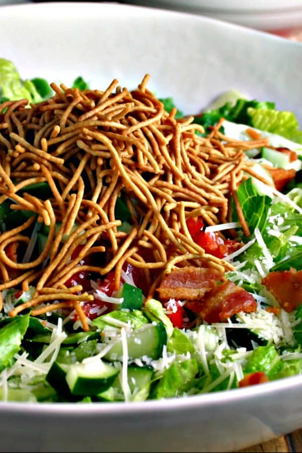 Insalata Della Casa with crispy rice noodles on top