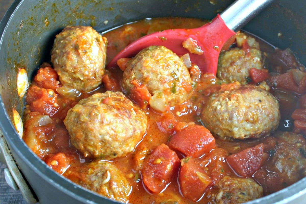 A pan filled with meatballs in sauce