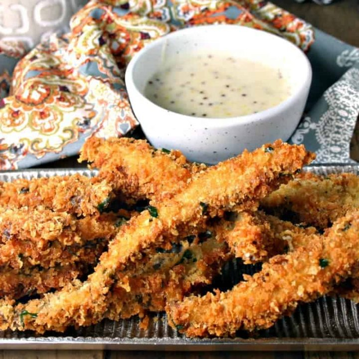 A plate of food on a table, with Portabello Fries with Belchamel Mustard Dipping Sauce