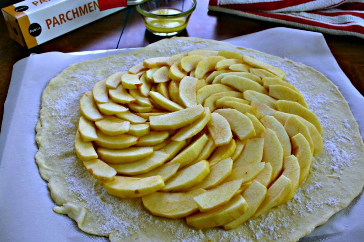 A pastry dough topped with apple slices