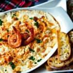 Cheesy Shrimp Dip in white baking dish
