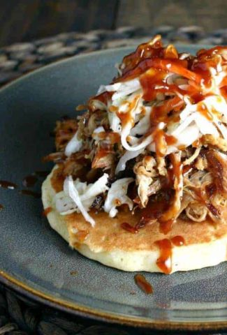 A plate of food with a fork, with Redneck Tacos and pulled pork