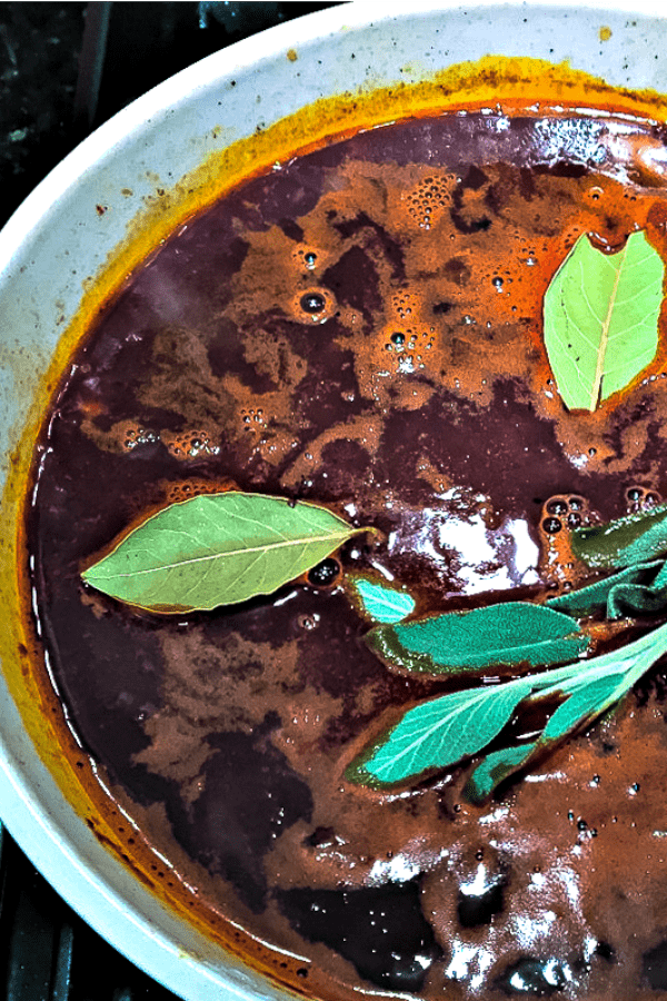 Broth for braised short ribs with fresh herbs