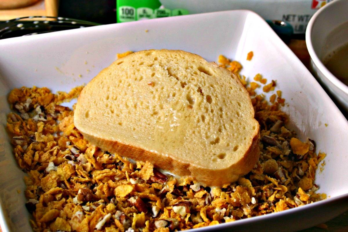 A bowl of cornflakes on a plate, with Crunchy French Toast