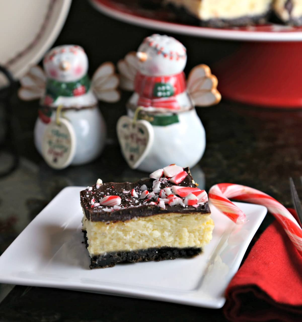 A close up of a Peppermint Cheesecake Bar on a plate