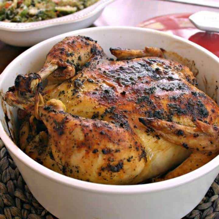 Sweet Basil Roasted Chicken in a Dutch oven on a table