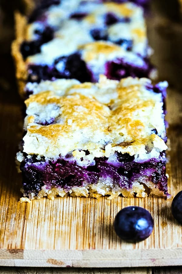 blueberry crumb bars on a cutting board
