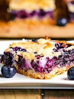 blueberry pie bar serving on white plate