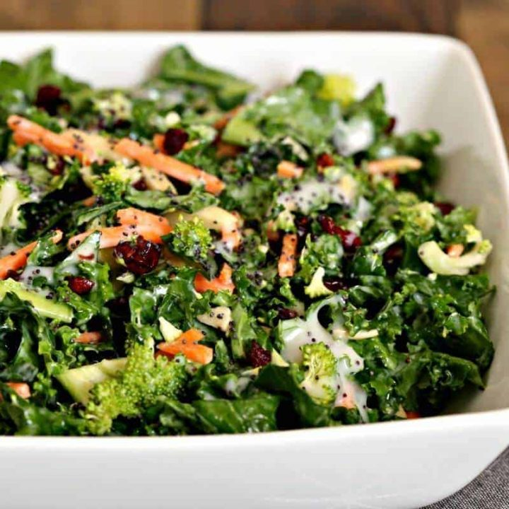 A close up of a bowl of salad, with Poppy Seed Kale Salad