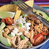 A plate of food with a fork, with Tex-Mex Chicken Burrito Bowl