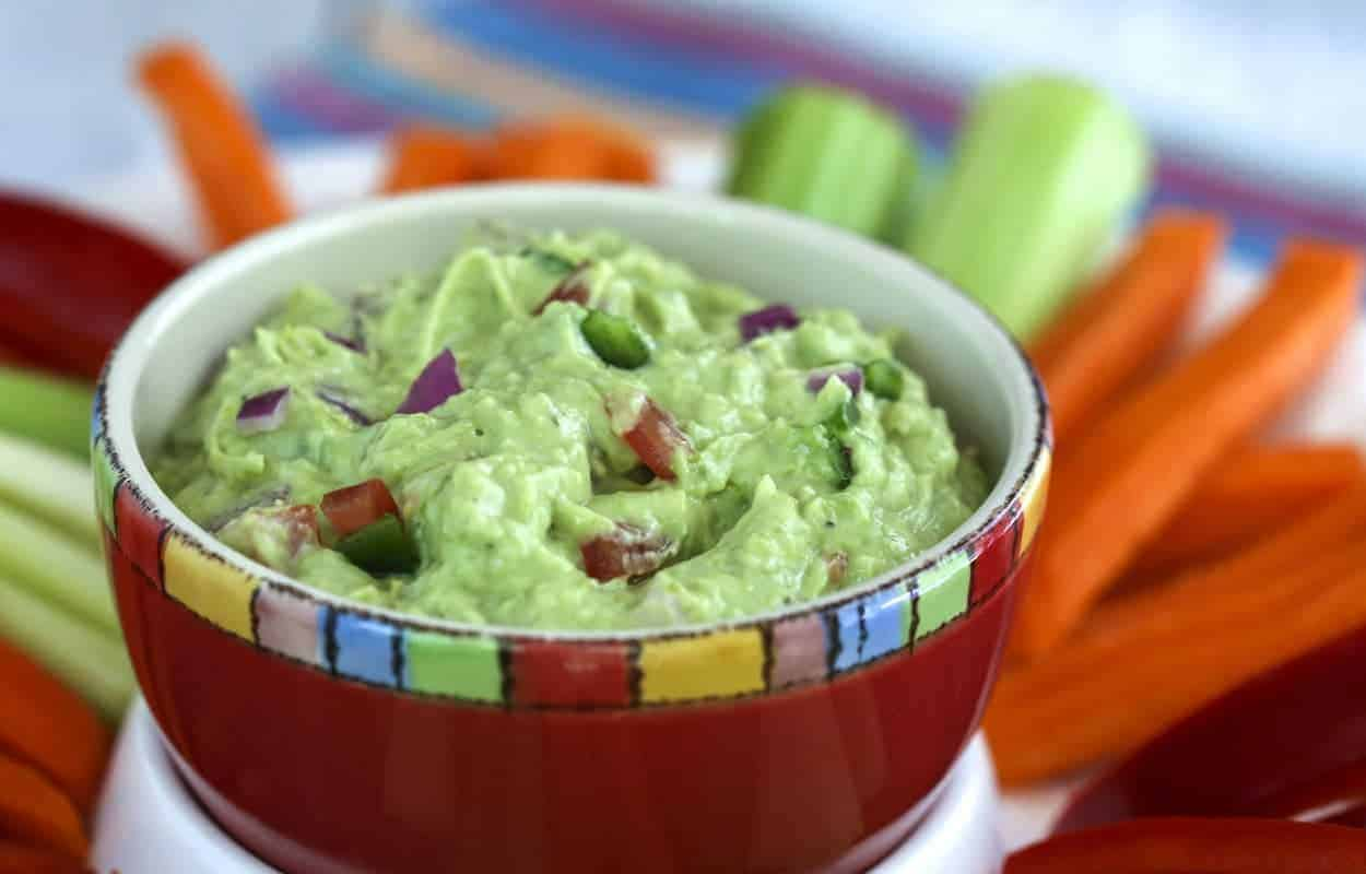 A close up of a bowl of food, with Guacamole