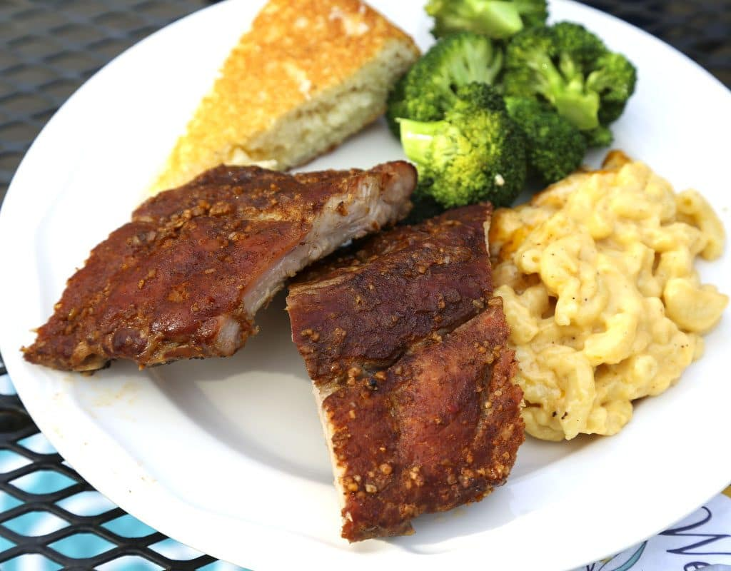 A plate of food with broccoli, macaroni and cheese, with Smoked Baby Back Ribs