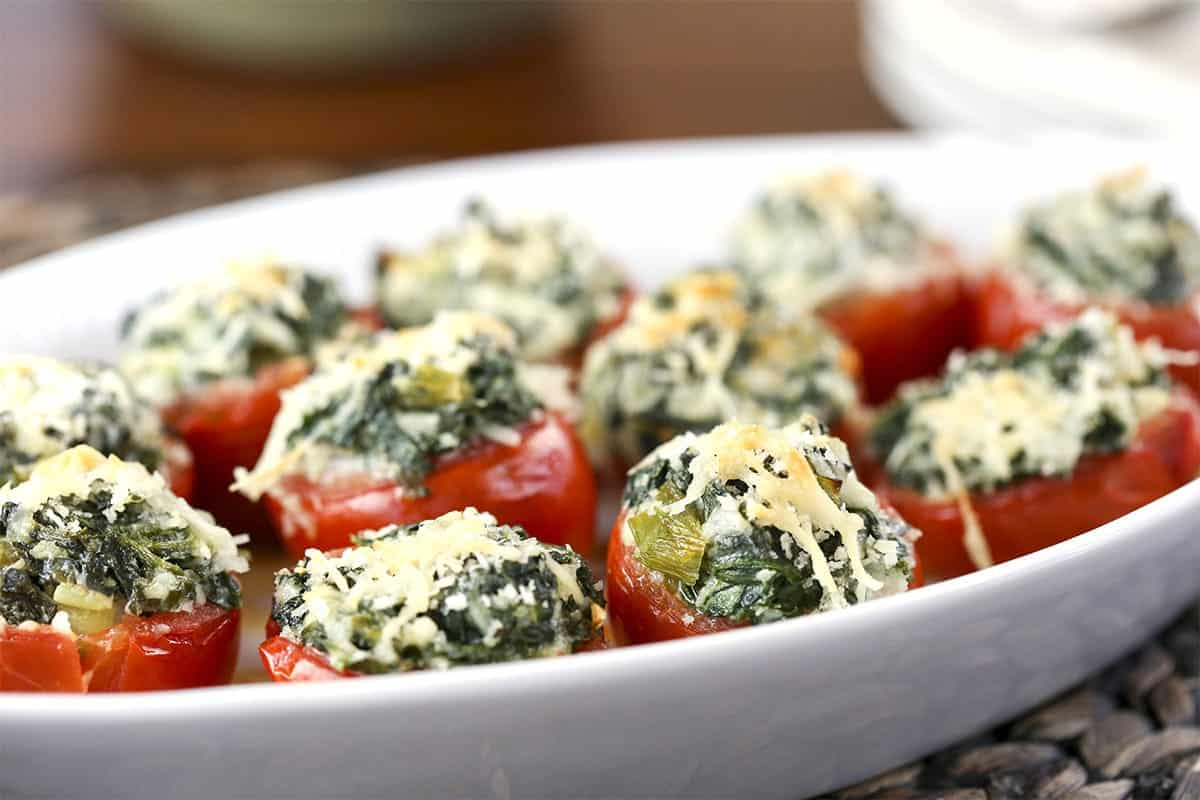 A close up of a plate of Spinach Stuffed Tomatoes