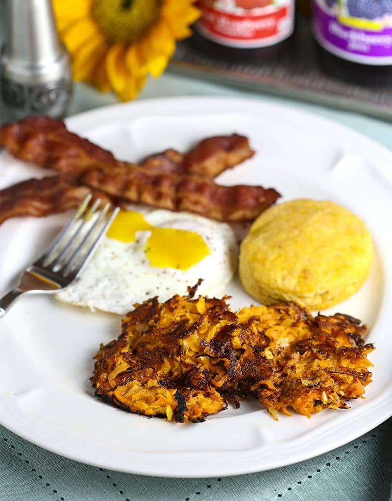 A plate of food on a table, with Sweet Potato Hash Browns