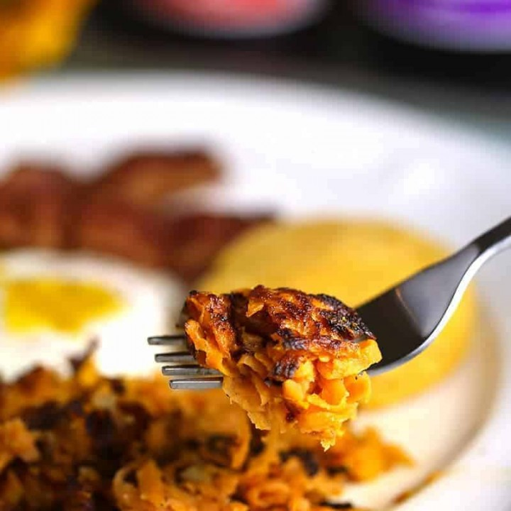 A close up of a plate of food with a fork, with Sweet Potato Hash Browns