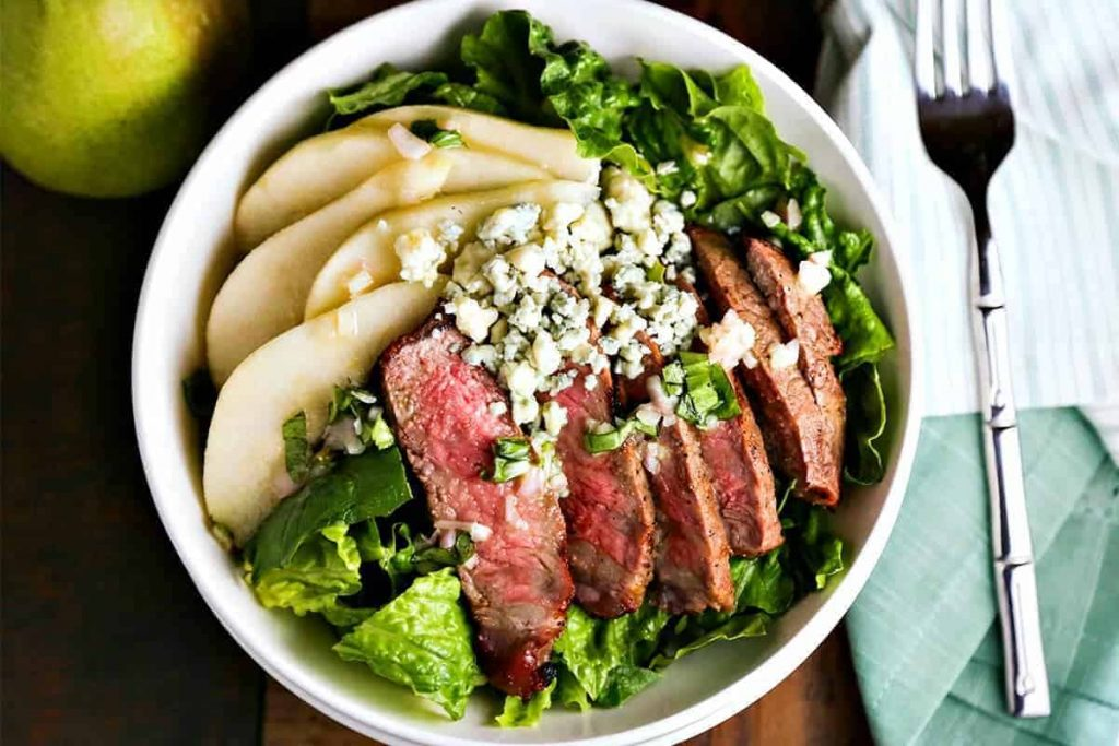 A bowl of Grilled Steak Salad with French Vinaigrette