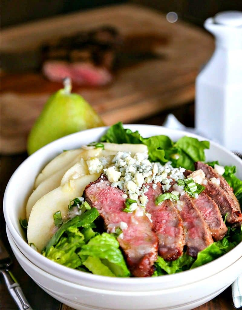 A close up of a bowl of Grilled Steak Salad with French Vinaigrette