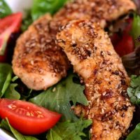 A plate of food with Sesame Chicken Salad