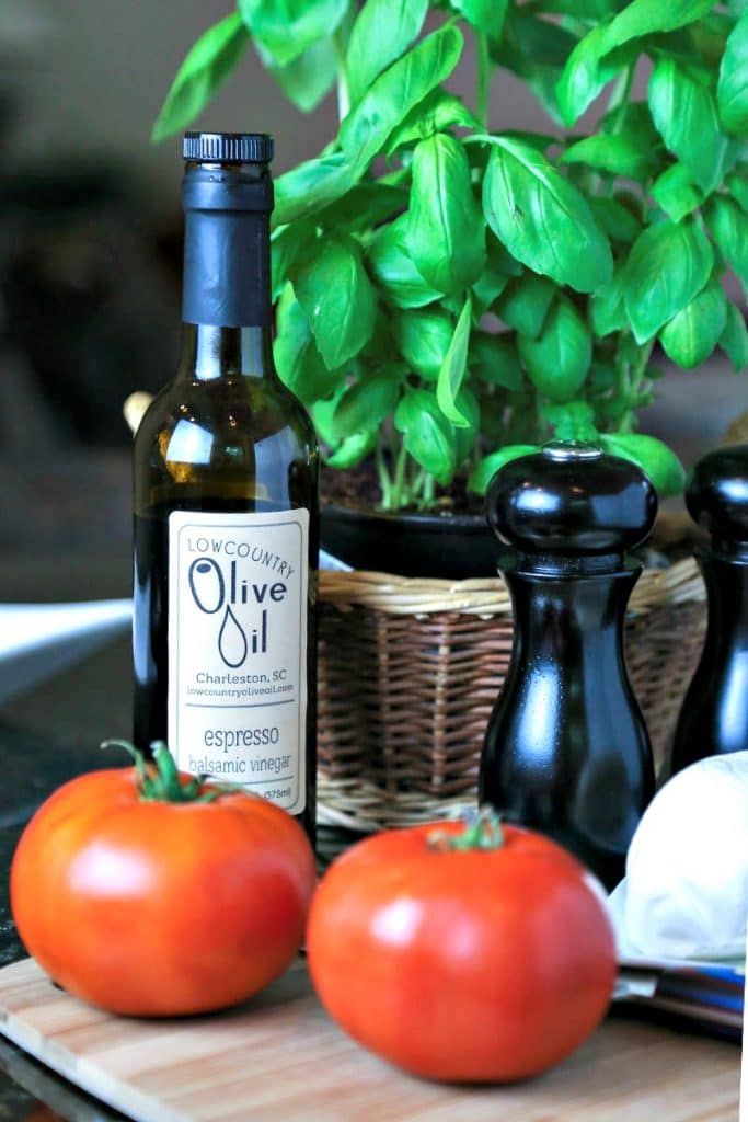 A bottle of wine on a olive oil