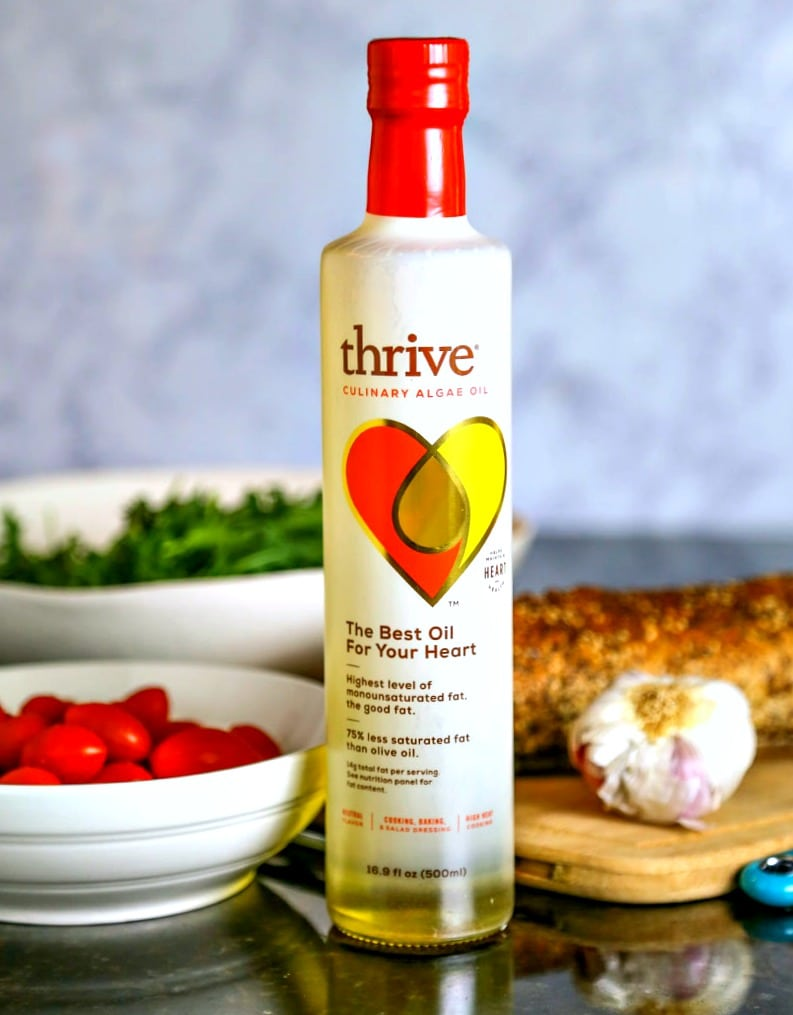 A close up of a bottle of Thrive Algae Oil