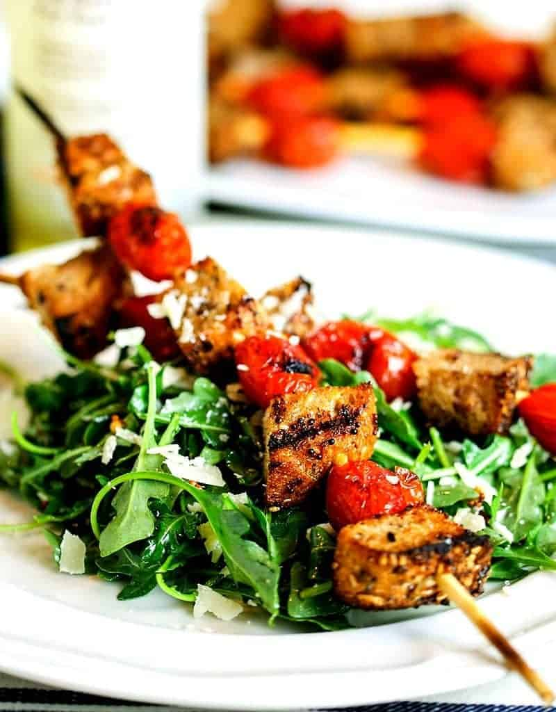 A plate of grilled panzanella skewer salad