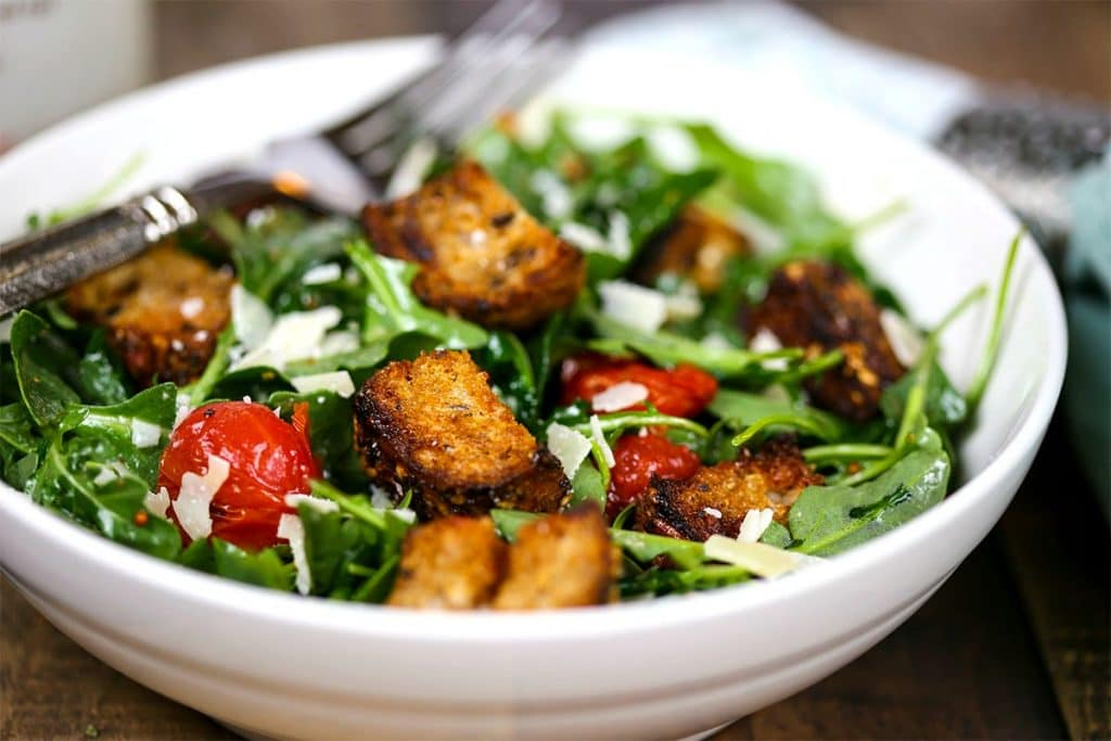 A bowl of grilled panzanella skewer salad
