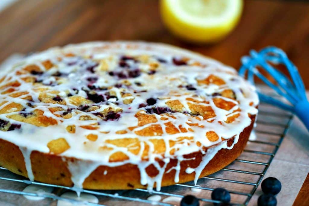 Blueberry Coffee Cake cooling on a wire rack on top of a wooden table
