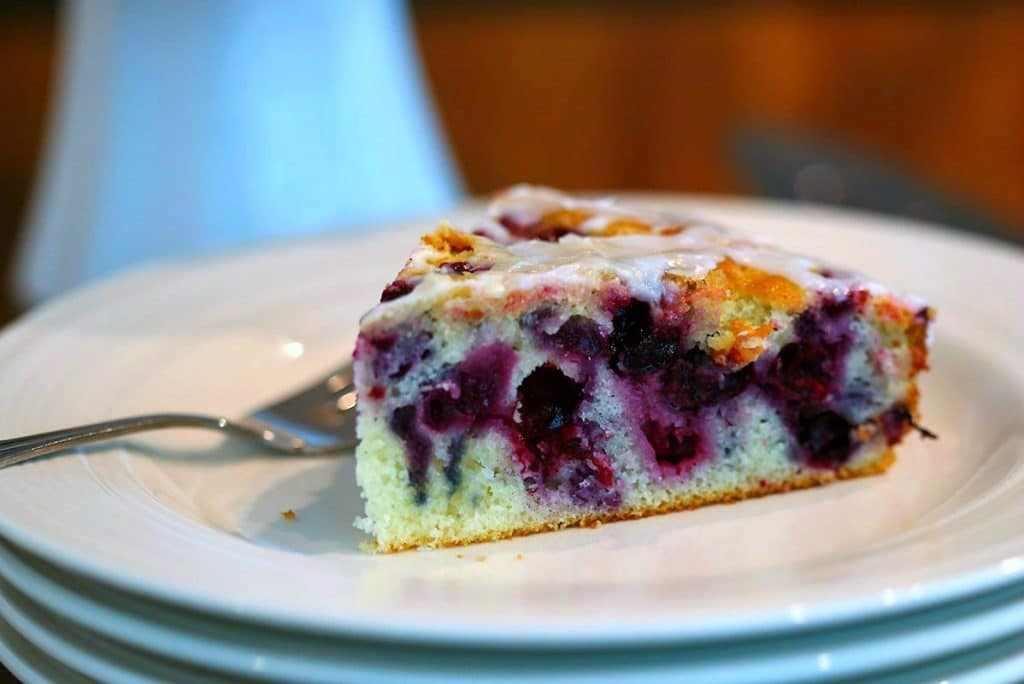 A close up of a slice of Blueberry Coffee Cake on a plate