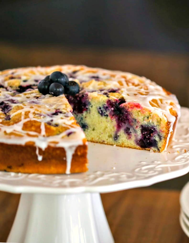 Blueberry Coffee Cake on a white cake stand