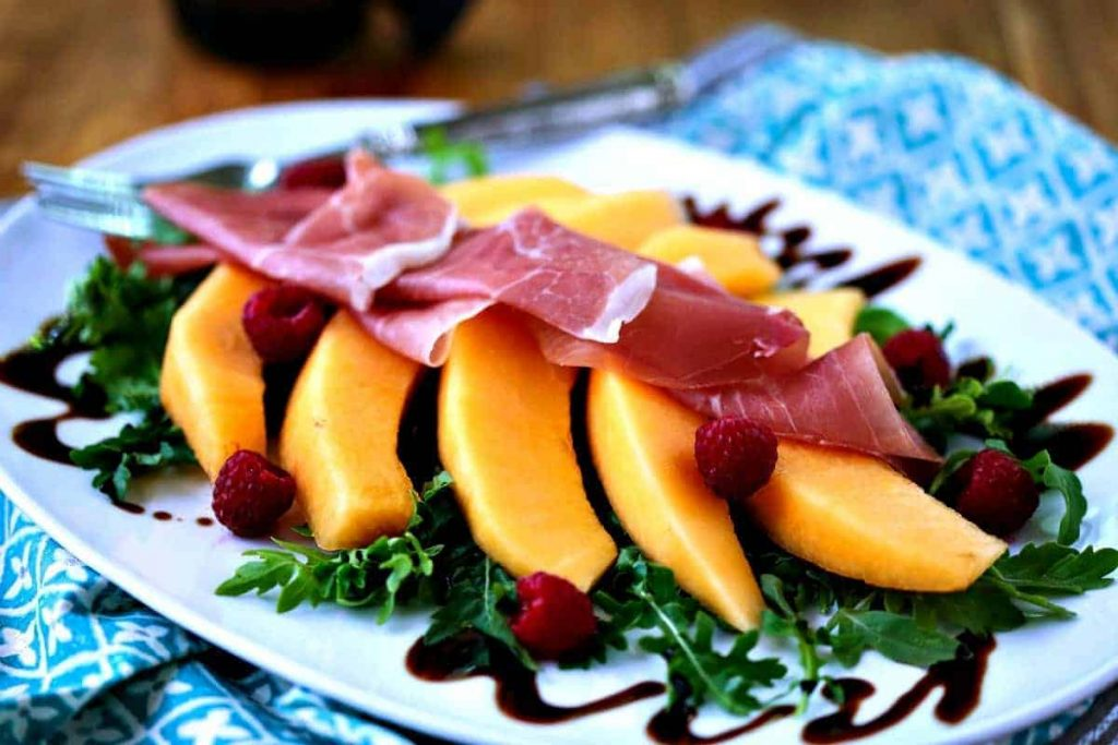 A plate of Cantaloupe and Prosciutto