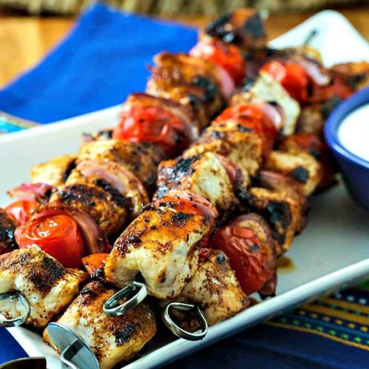 A plate of Smoky Chicken Kabobs on a table