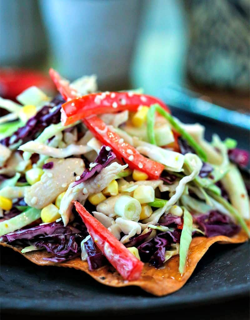 A close up of a plate of Asian Slaw with Egg Roll Crackers