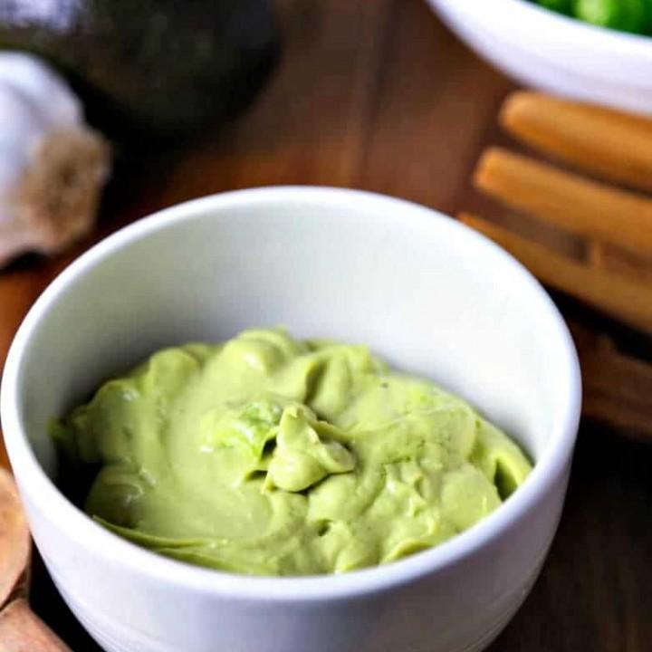 A bowl of avocado caesar dressing