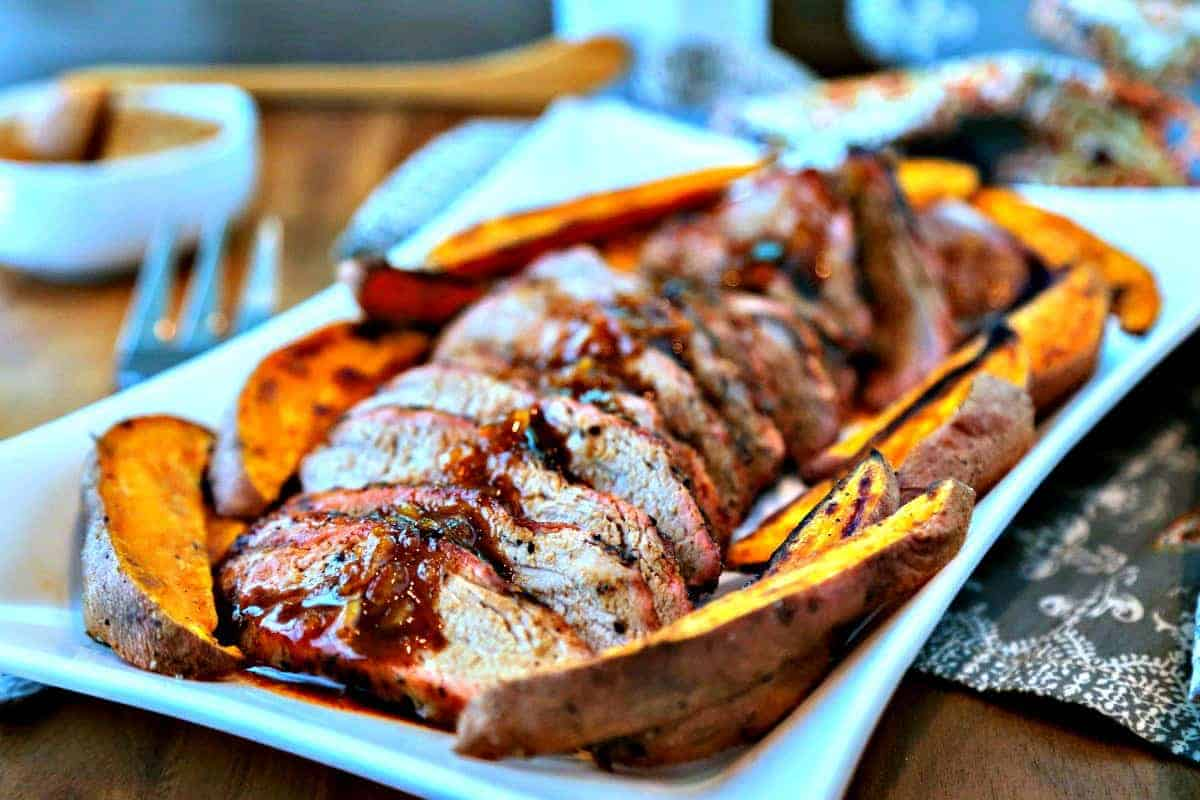 A plate of sliced Chili-Orange Glazed Pork Tenderloin