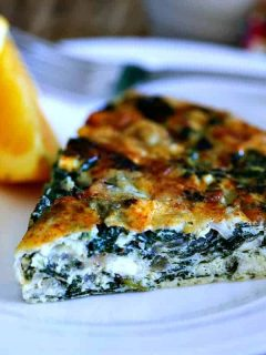 A slice of crustless spinach quiche