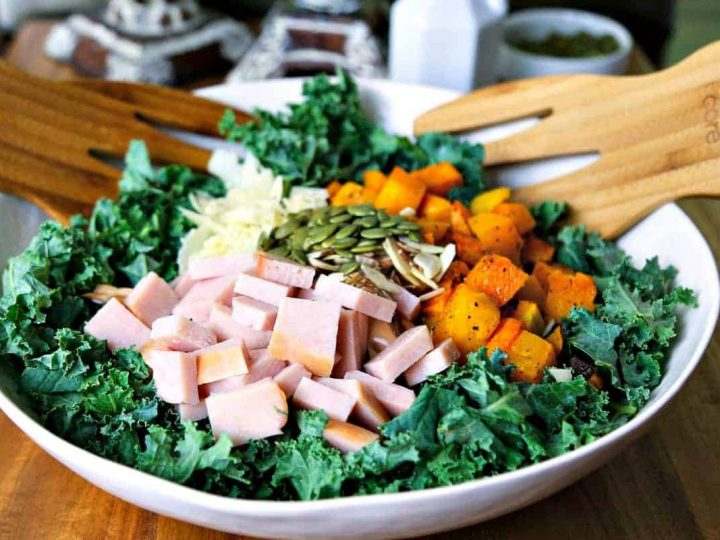 A bowl of autumn salad with butternut squash, turkey, and kale