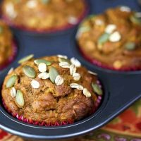 Pumpkin Oat Muffins in paper liners in a muffin pan