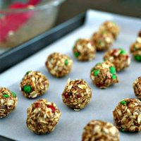 A bunch of peanut butter oatmeal energy bites on a parchment paper lined tray