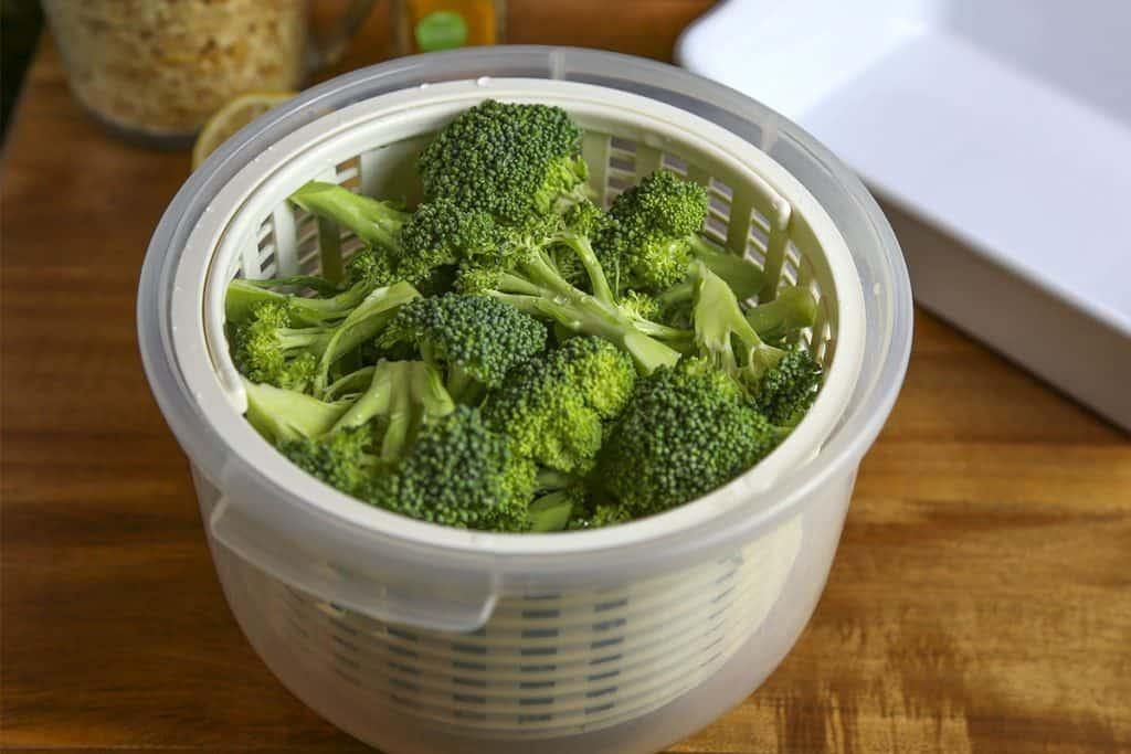 A microwave steamer with broccoli