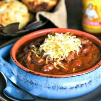 A bowl of  Slow Cooker Tex-Mex Chili topped with cheese