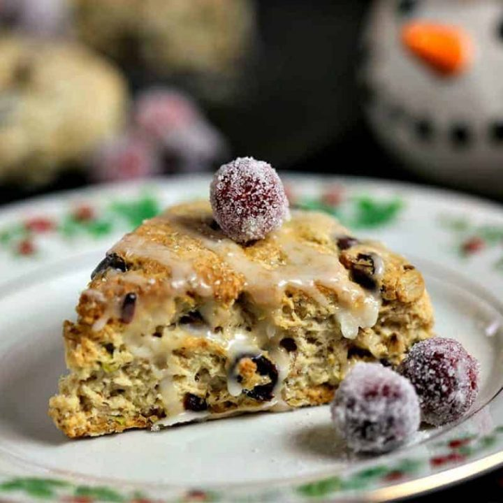 A close up of a cranberry pistachio scone on a plate