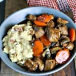 Marsala Beef Stew with Redskin Mashed Potatoes. A rich stew of beef, mushrooms, and carrots served over creamy rustic masted potatoes.