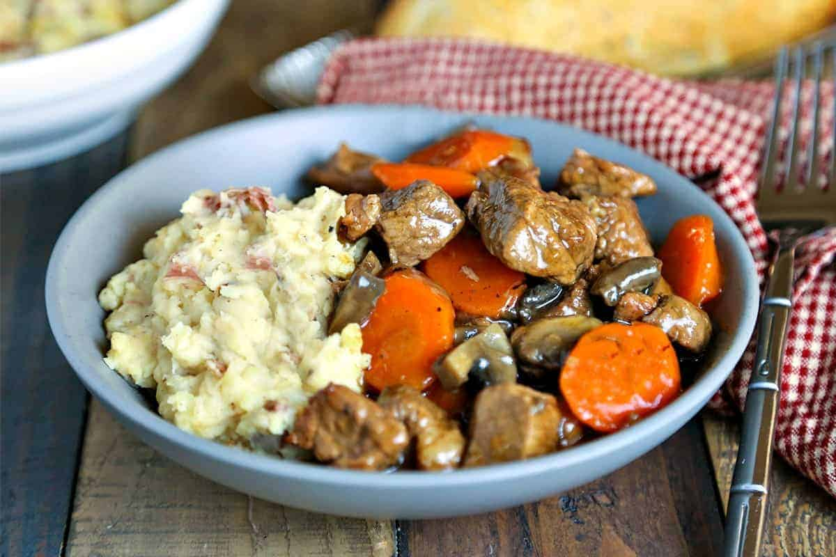 Marsala Beef Stew with Redskin Mashed Potatoes in blue bowl