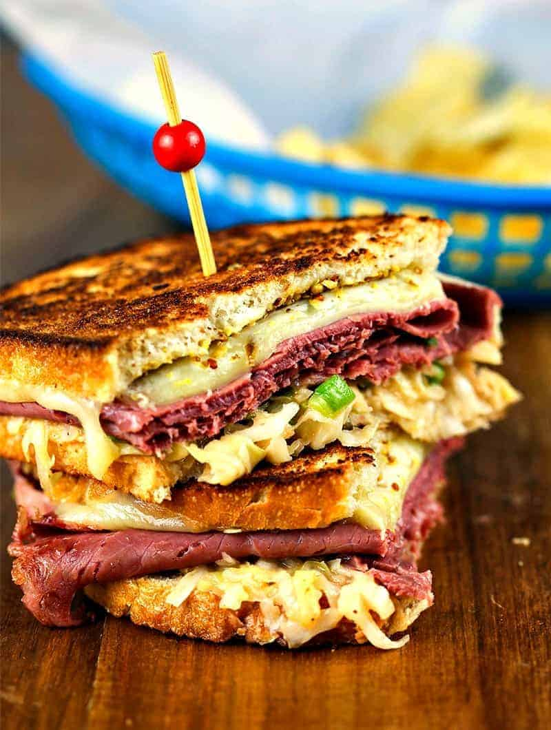 Super Coleslaw Reuben Sandwiches stacked with toothpick