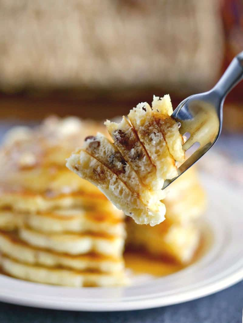 Coconut Pecan Pancakes speared on a fork